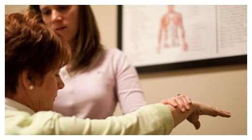 Chiropractor Durham NC Cortney Dice with Patient